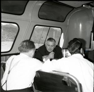 Leader of the Opposition, Norman Kirk, on flight to Te Anau with Lindsay Crozier, 1966